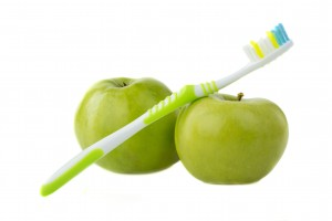 apple with a toothbrush, isolated on white